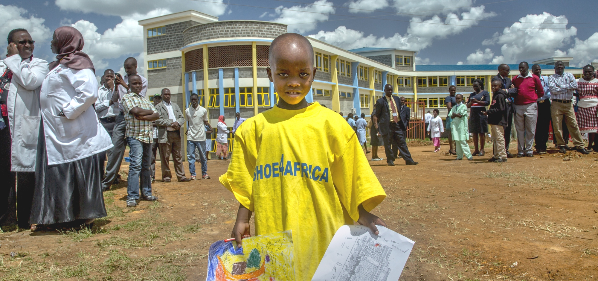 """The opening of Moi Teaching and Referral Hospital for Children in Eldoret, Kenya's Rift Valley. The project is donor funded and overseen in its entirity by Shoe4Africa, a foundation whose """"challenge is to listen and work with communities to better lives focusing on Health & Education"""" and the foundation's CEO Toby Tanser."""