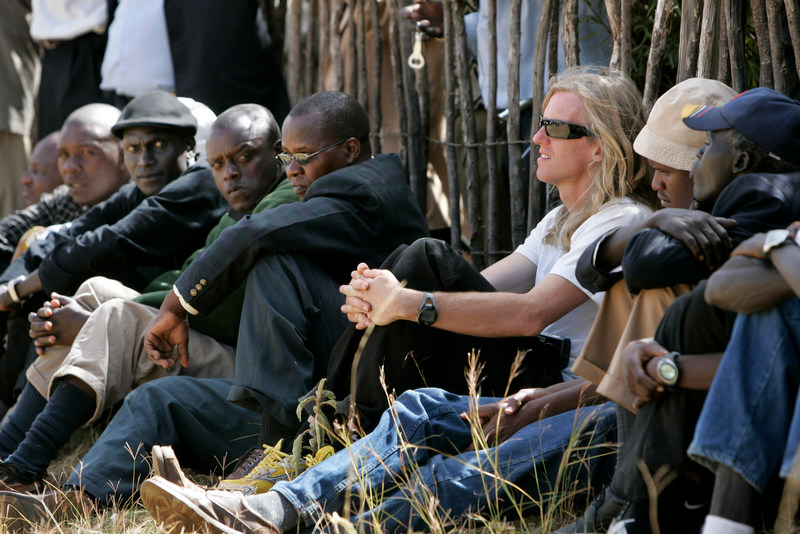 Former athlete Toby Tanser of Sweden, who lives in New York and was representing the New York Road Runners Board of Directors, center-right, and Kenyan long-distance runner Robert Cheruiyot, second from left, attend the funeral of Kenyan Olympic athlete Lucas Kipkemboi Sang, who was killed in post-election violence, in the village of Kuinet, near the town of Eldoret, in Kenya, Thursday, Jan. 10, 2008. The body of Olympian Lucas Sang was found in western Kenya on New Year's Eve with a deep gash to the back of his head and severe burns, said close friend Moses Tanui, a former world 10,000-meter champion. Sang, who was in his 50s, was a 400-meter runner who made the quarter finals of the men's race in 1988 and the same year ran in the finals as a member of the 4x400m relay. (AP Photo/Ben Curtis)
